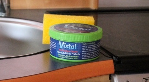 Tub of Vistal Multi Surface Cleaner with yellow sponge in a caravan or motorhome kitchen